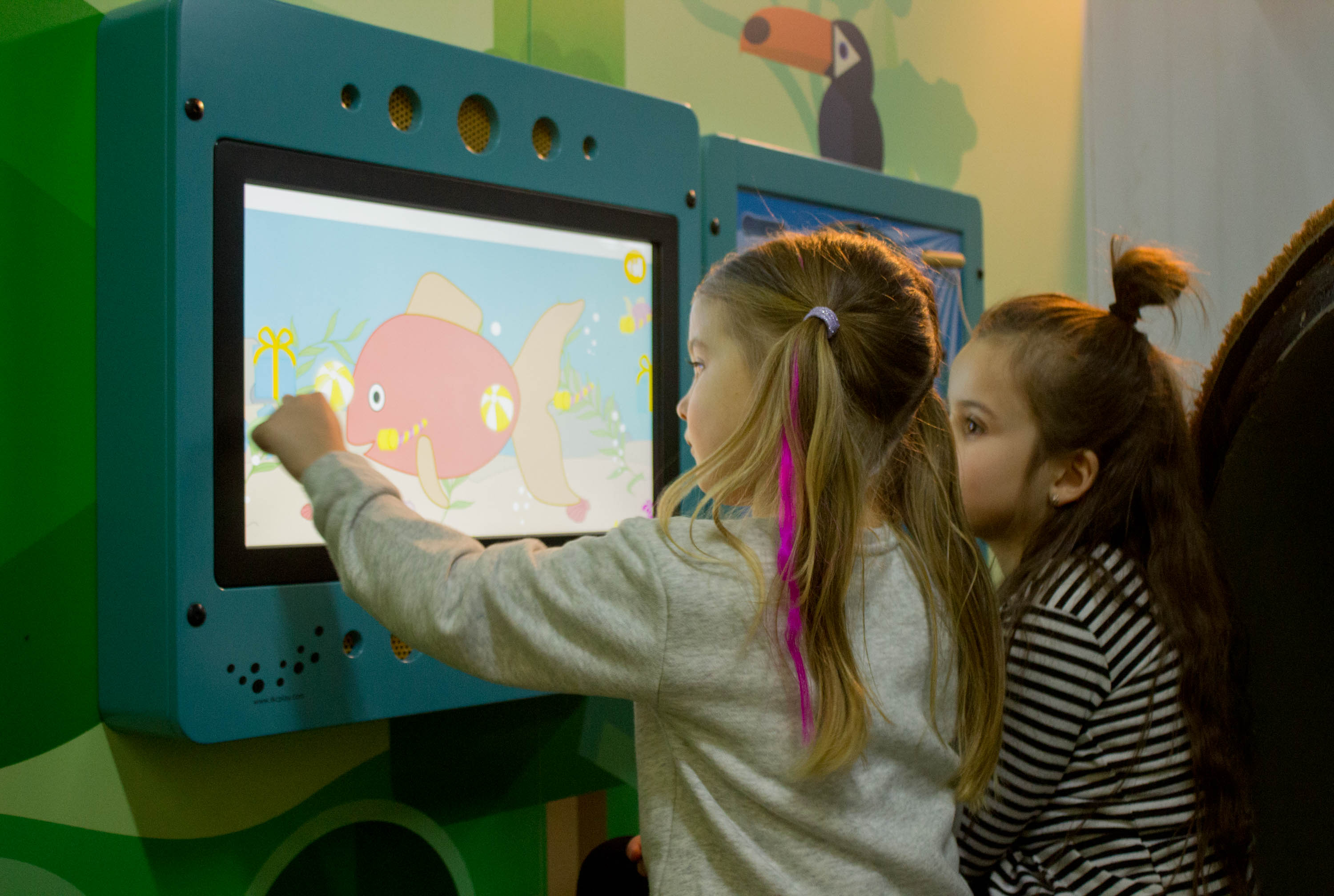 this image shows 2 kids with an interactive play system