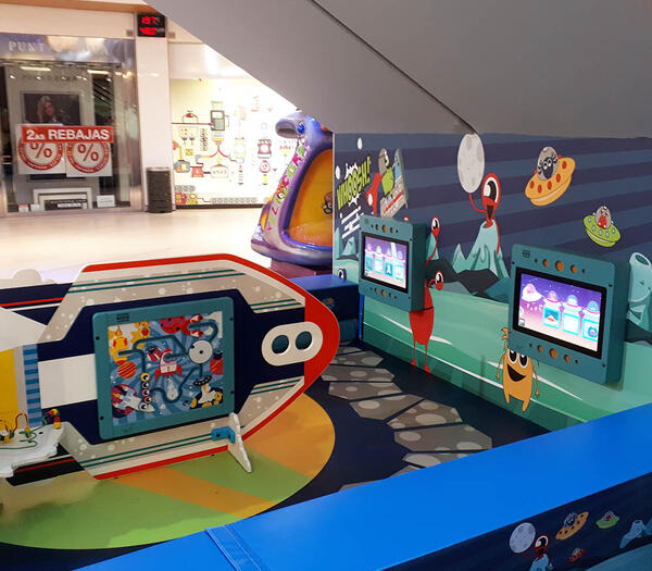 This image shows a custom kids corner within a shopping center in Spain